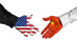 American and Chinese leaders shaking hands on a deal agreement