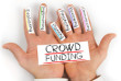 Photo of hands holding paper cards with CROWD FUNDING concept words
