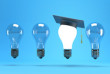 lightbulb with graduation hat  on a blue background