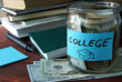 Jar with label and money on the table.